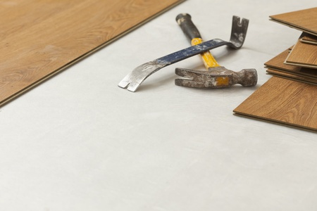 pry: Worn Hammer and Pry Bar with Laminate Flooring Abstract with Copy Room.