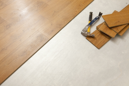 Worn Hammer and Pry Bar with Laminate Flooring Abstract with Copy Room. photo