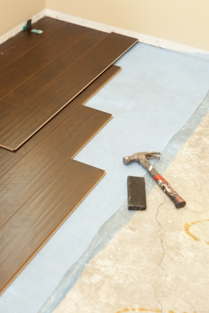 interiour: Hammer and Block with New Laminate Flooring Abstract.