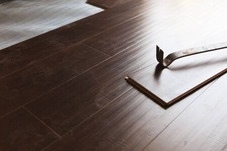 pry: Pry Bar Tool with New Laminate Flooring Abstract.