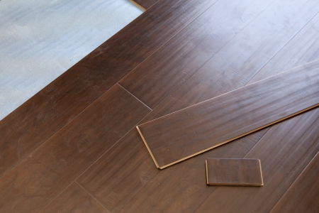 Newly Installed Brown Laminate Flooring Abstract. photo