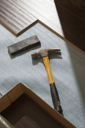 Hammer and Block with New Laminate Flooring Abstract. photo