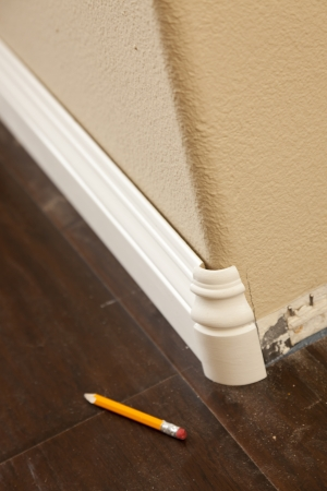 New Baseboard and Bull Nose Corners with Laminate Flooring Abstract. photo