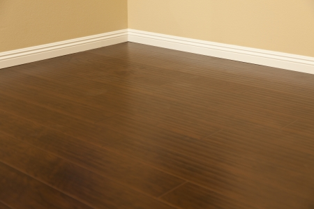 laminate: Beautiful Newly Installed Brown Laminate Flooring and Baseboards in Home.