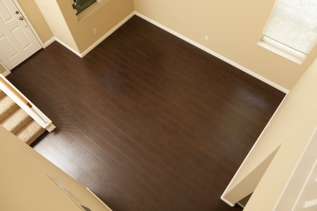 parquet flooring: Beautiful Newly Installed Brown Laminate Flooring and Baseboards in Home.