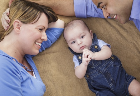 Mixed Race Family Playing Face Up on the Blanket. Stock Photo - 14246837