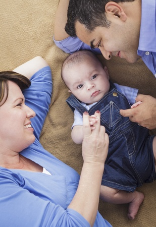 Mixed Race Family Playing Face Up on the Blanket. Stock Photo - 14246833