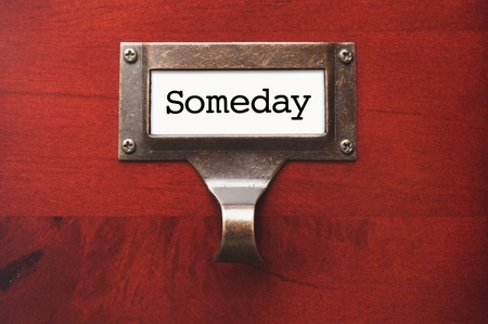 lustrous: Lustrous Wooden Cabinet with Someday File Label in Dramatic LIght. Stock Photo