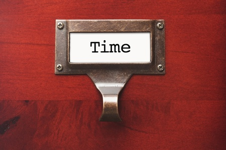lustrous: Lustrous Wooden Cabinet with Time File Label in Dramatic LIght. Stock Photo