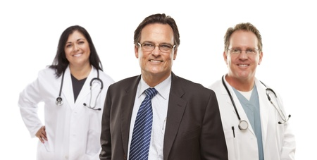 Handsome Businessman with Medical Female and Male Doctors or Nurses Behind Isolated on White.