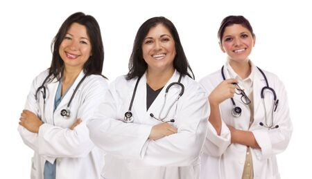 Three Hispanic Female Doctors or Nurses Isolated on a White Background. photo