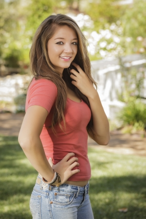 french model: Attractive Mixed Race Girl Portrait Outdoors. Stock Photo