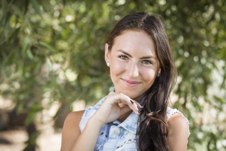 spanish looking: Attractive Smiling Mixed Race Girl Portrait Outdoors.