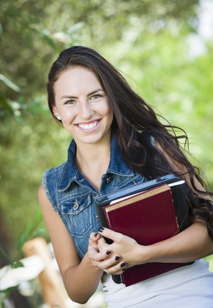 mexican girl: Attractive Smiling Mixed Race Young Girl Student with School Books Outdoors. Stock Photo
