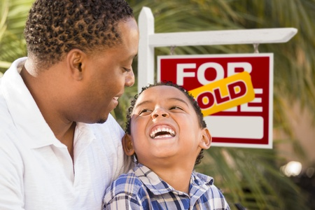 Happy African American Father and Mixed Race Son in Front of Sold Real Estate Sign. Stock Photo - 14990552