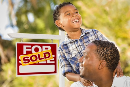 Happy African American Father and Mixed Race Son in Front of Sold Real Estate Sign. Stock Photo - 14990556