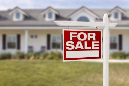 sales agent: For Sale Real Estate Sign in Front of Beautiful New Home. Stock Photo