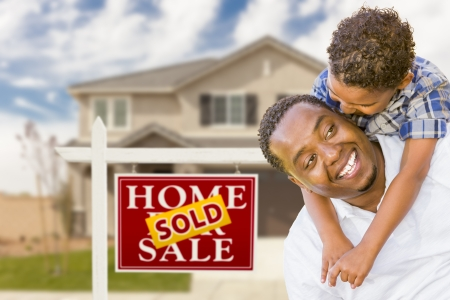 sold sign: Happy Mixed Race Father and Son In Front of Sold Real Estate Sign and New House. Stock Photo