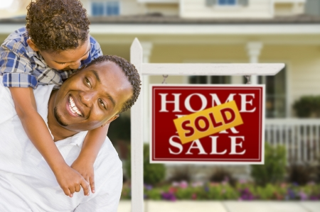Happy Mixed Race Father and Son In Front of Sold Real Estate Sign and New House. Stock Photo - 15013648