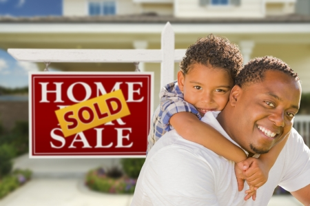 Happy Mixed Race Father and Son In Front of Sold Real Estate Sign and New House. Stock Photo - 15013588