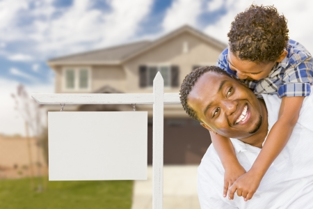 multi family house: Happy African American Father and Mixed Race Son In Front of Blank Real Estate Sign and New House.