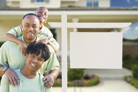 realtor: African American Family In Front of Blank Real Estate Sign and New House.