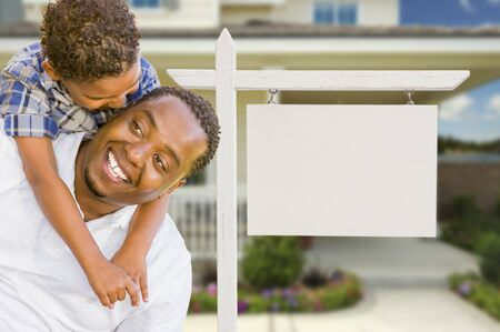 Happy African American Father and Mixed Race Son In Front of Blank Real Estate Sign and New House. Stock Photo - 15475698