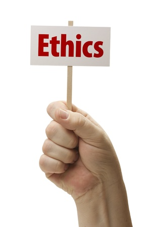 ethics: Ethics Sign In Male Fist Isolated On A White Background  Stock Photo