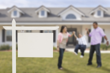 Blank Real Estate Sign and Playful Hispanic Family in Front of House. photo