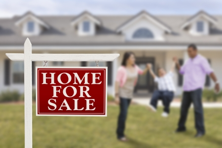 home sale: Home For Sale Real Estate Sign and Playful Hispanic Family in Front of House. Stock Photo
