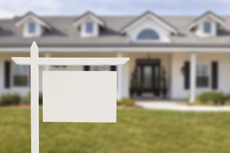 Blank Real Estate Sign in Front of Beautiful New House. photo