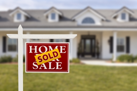 front house: Sold Home For Sale Sign in Front of Beautiful New House. Stock Photo