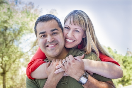 latino man: Happy Attractive Mixed Race Couple Piggyback at the Park.
