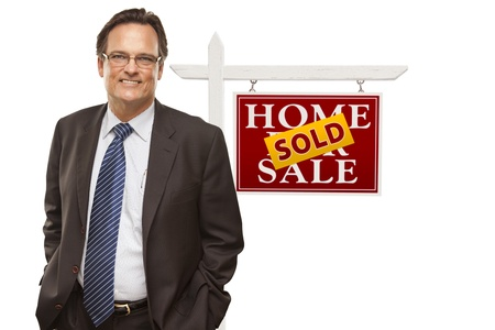 Businessman in Front of Sold Home For Sale Real Estate Sign Isolated on a White Background  Stock Photo - 15867521