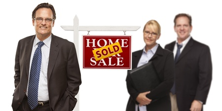 Businessmen and Businesswoman with Sold Home For Sale Real Estate Sign Isolated on a White Background  Stock Photo - 15867525