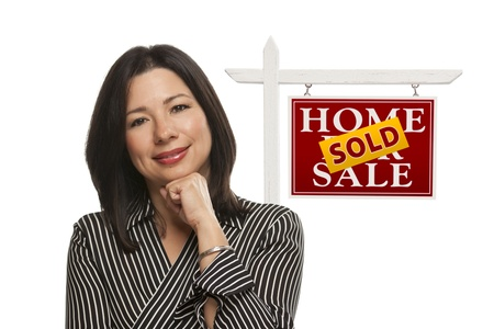 Ethnic Woman in Front of Sold Home For Sale Real Estate Sign Isolated on a White Background  Stock Photo - 15867520