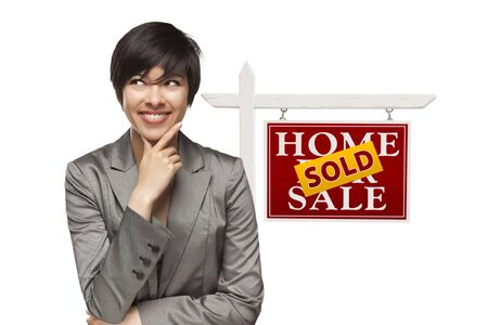 Ethnic Woman in Front of Sold Home For Sale Real Estate Sign Isolated on a White Background Stock Photo - 15867522