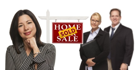 Mixed Race People with Sold Home For Sale Real Estate Sign Isolated on a White Background  Stock Photo - 15867523