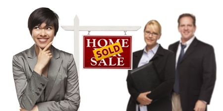 sales person: Mixed Race People with Sold Home For Sale Real Estate Sign Isolated on a White Background