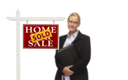 Businesswoman Behind Sold Home For Sale Real Estate Sign Isolated on a White Background. Stock Photo - 15867516