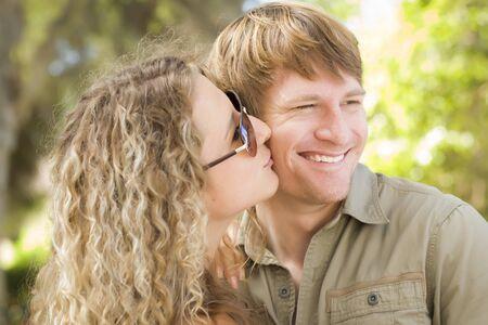 Happy Attractive Loving Couple Portrait in the Park. photo