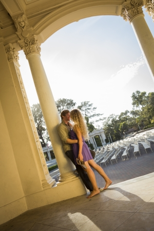 two women hugging: Attractive Playful Loving Couple Portrait in the Outdoor Amphitheater.