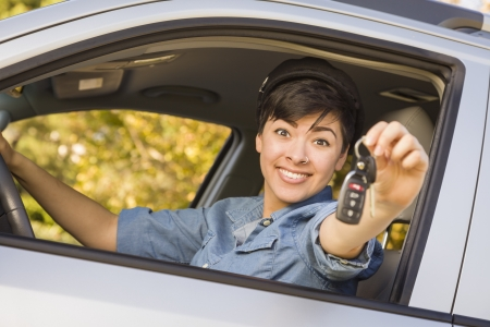 Happy Smiling Mixed Race Woman in Car Holding Set of Keys.