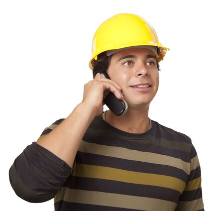Handsome Hispanic Hispanic Male Contractor Wearing Hard Hat on Cell Phone Isolated on a White Background. photo