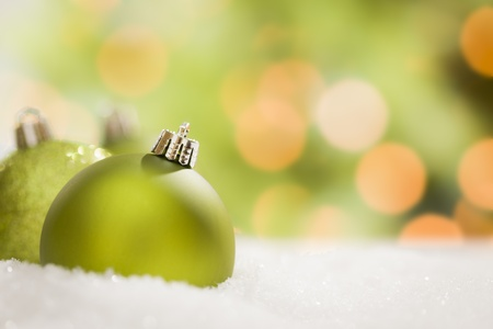 Beautiful Matt Green Christmas Ornaments on Snow Flakes  photo