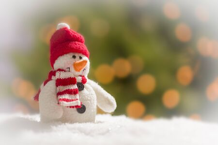 Cute Snowman Over Green and Gold Abstract Background. photo