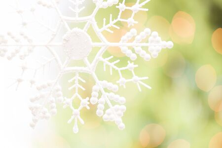 White Glittery Snowflake Over an Abstract Green and Gold Background. Stock Photo - 16511397