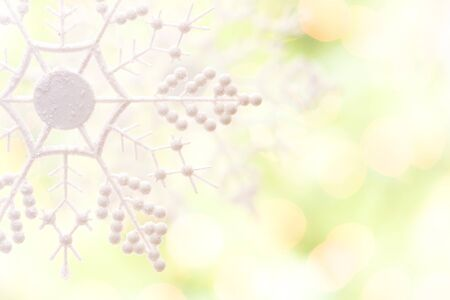 White Glittery Snowflake Over an Abstract Green and Gold Background. Stock Photo - 16511380