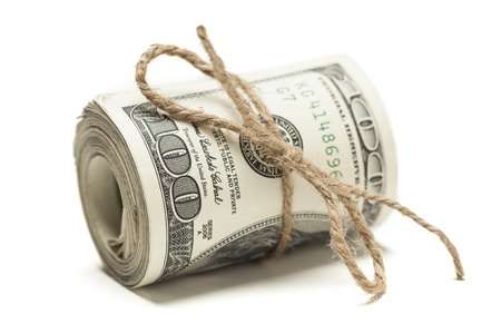 us dollar bill: Roll of One Hundred Dollar Bills Tied in Burlap String Isolated on a White Background.
