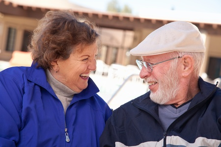 Happy Senior Adult Couple Portrait Bundled Up Outdoors. photo